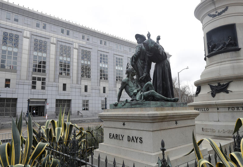 "FILE - This March 2, 2018 file photo shows a statue that depicts a Native American at the feet of a Spanish cowboy and Catholic missionary in San Francisco. A San Francisco board has decided to remove the 19th-century statue that activists say is racist and demeaning to indigenous people. The San Francisco Board of Appeals voted Wednesday, Sept. 12, 2018, on the ""Early Days"" statue. (AP Photo/Jeff Chiu, File)"