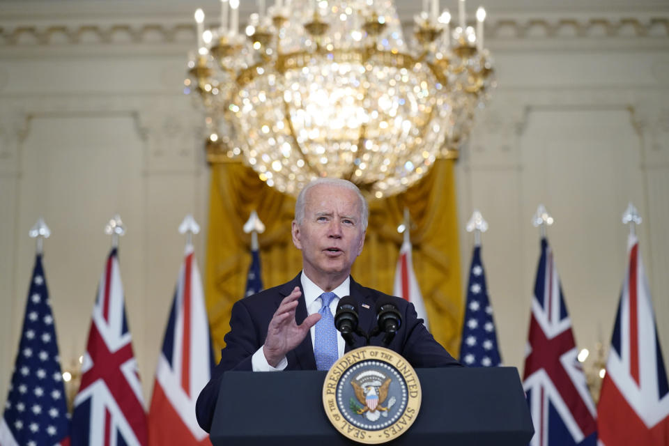 President Joe Biden, joined virtually by Australian Prime Minister Scott Morrison and British Prime Minister Boris Johnson, speaks about a national security initiative from the East Room of the White House in Washington, Wednesday, Sept. 15, 2021. (AP Photo/Andrew Harnik)