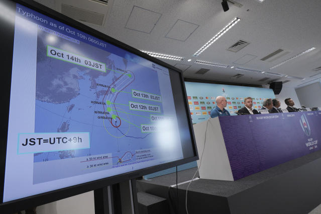 A typhoon course map of Hagibis is seen as Alan Gilpin, tournament director for the 2019 Rugby World Cup and Japan Rugby 2019 CEO Akira Shimazu attending during a press briefing on update relating to the anticipated impact of Typhoon Hagibis on the final round Rugby World Cup 2019 pool matches this weekend Thursday, Oct. 10, 2019, in Tokyo. (AP Photo/Eugene Hoshiko)