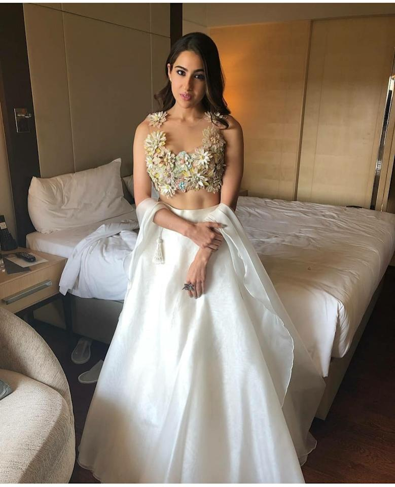 Having established herself as the most sought after face in fashion, the actress-in-the-making relished her Cinderella moment at the trailer launch of <em>Kedarnath</em>. The perfect blend of <em>lehenga</em> and a ballroom gown featured a tiny blouse loaded with floral appliques all in the pastel shades of pink, green, blue and cream. The silk skirt was blessed with abundant flair to add to the starlet's princess-esque aura.
