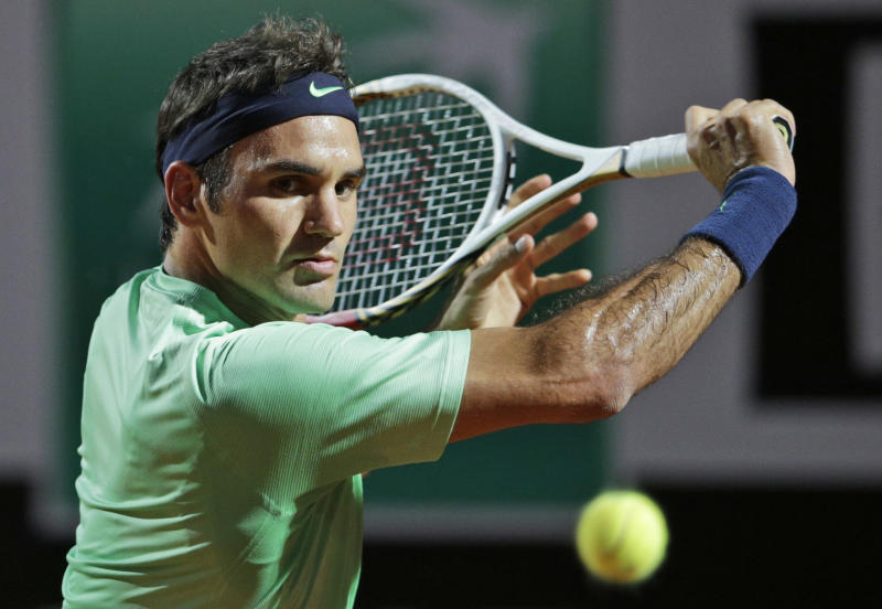 Switzerland's Roger Federer returns the ball to France's Benoit Paire during their semi final match at the Italian Open tennis tournament in Rome, Saturday, May 18, 2013. (AP Photo/Andrew Medichini)