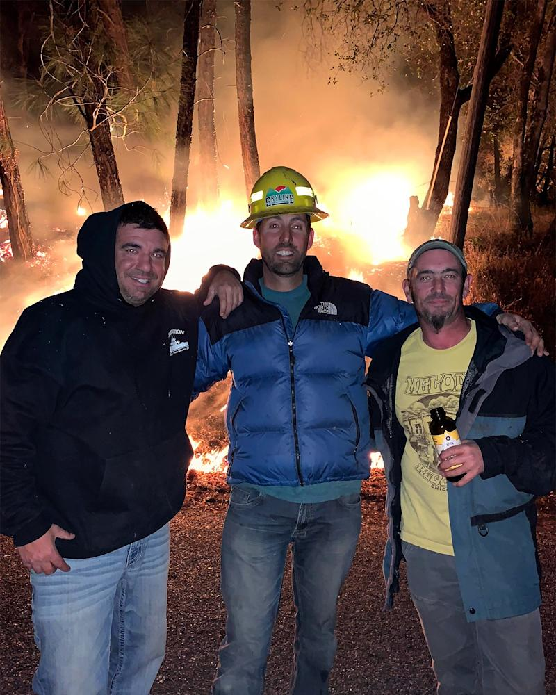 Exhausted but undaunted, Dharma LaRocca, Jason McCord, and Jeb Sisk pose for a photo that was later shared widely among those who'd evacuated the canyon—and were cheering their friends from afar.