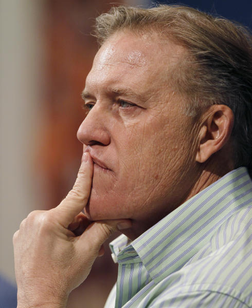 John Elway, the Denver Broncos executive vice president of football operations, listens to questions about his team's loss to the Baltimore Ravens in an AFC playoff game during a news conference at the team's headquarters in Englewood, Colo., on Monday, Jan. 14, 2013. (AP Photo/David Zalubowski)