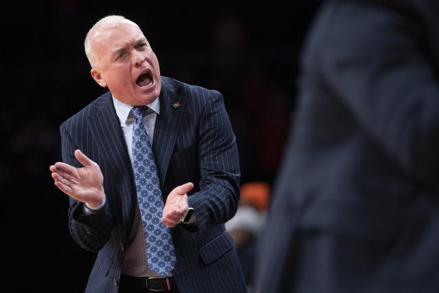 Penn State head coach Patrick Chambers reacts during the first half of an NCAA college basketball game against Syracuse in the consolation round of the NIT Season Tip-Off tournament, Friday, Nov. 29, 2019, in New York. (AP Photo/Mary Altaffer)