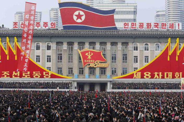 In a mass rally the Pyongyang city army-people celebrate the election of Kim Jong Un as General Secretary of the WPK (Workers' Party of Korea), overlooked by inspirational national symbols at Kim Il Sung Square in Pyongyang, North Korea, Friday Jan. 15, 2021. (AP Photo/Jon Chol Jin)
