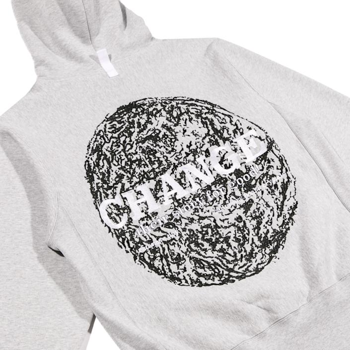 "The back of the hooded sweatshirt features the Red Nose Day-inspired slogan, ""Change their story for good!"" over the brand's Earth-style graphic. <span class=""copyright"">(Zaul Zamora)</span>"