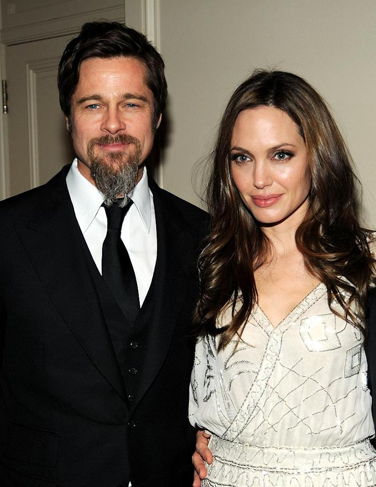 "<i>In Touch</i> reports Brad Pitt feels ""betrayed"" by Angelina Jolie after having seen a screening of her upcoming film, ""The Tourist."" The magazine says he was shocked by her love scenes with Johnny Depp, which were more ""passionate and risque than he was ever told by Angie."" According to <i>In Touch</i>, Jolie had previously assured Pitt the scenes were ""tame."" For dish on the real betrayal, click over to <a href=""http://www.gossipcop.com/angelina-jolie-sex-scenes-johnny-depp-the-tourist-movie-brad-pitt-moneyball/"" target=""new"">Gossip Cop</a>. Kevin Mazur/<a href=""http://www.wireimage.com"" target=""new"">WireImage.com</a> - December 10, 2009"