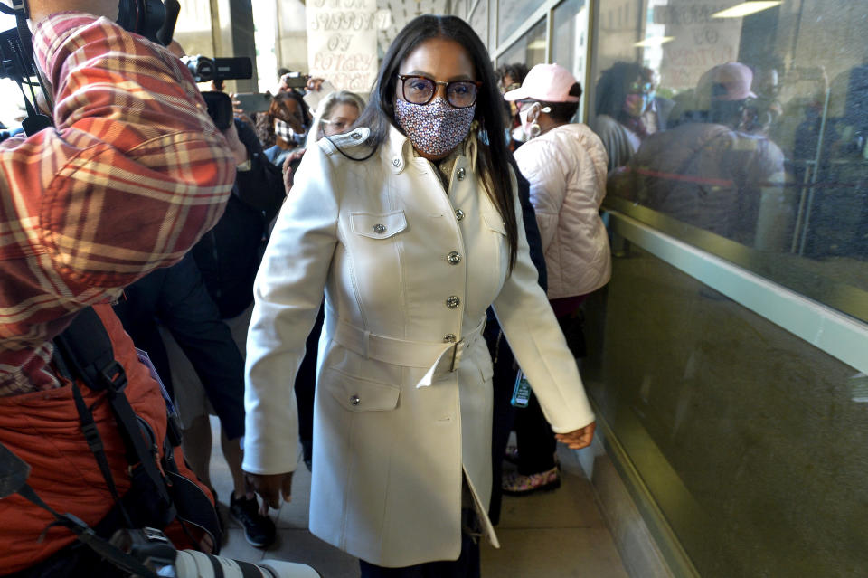 Rochester Mayor Lovely Warren walks out of city court after her arraignment in Rochester, N.Y., Monday, Oct. 5, 2020. Warren, who has faced calls to resign over her city's handling of the suffocation death of Daniel Prude at the hands of police, pleaded not guilty Monday to campaign finance charges dating to her 2017 reelection campaign. (AP Photo/Adrian Kraus)