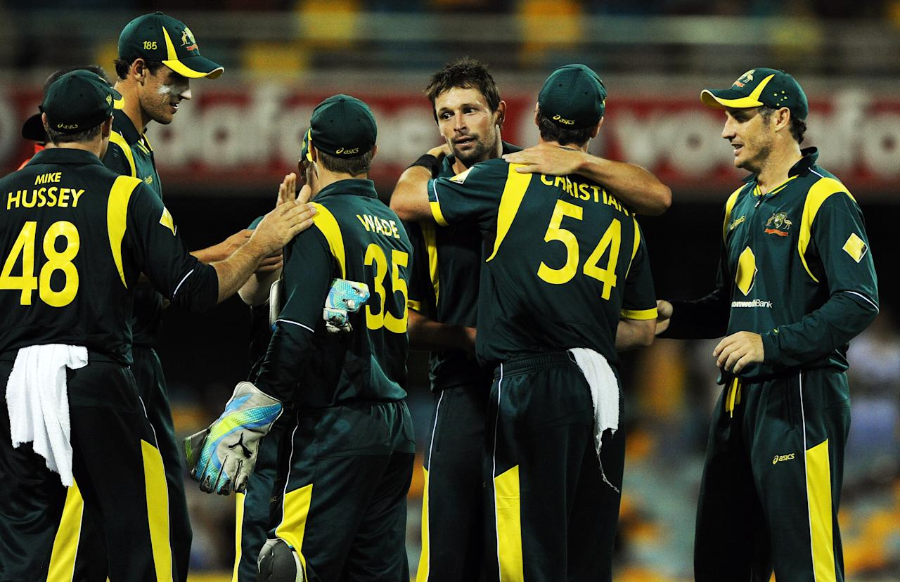 Australia celebrates their win over India during their one-day international cricket match in Brisbane on February 19, 2012. IMAGE STRICTLY RESTRICTED TO EDITORIAL USE - STRICTLY NO COMMERCIAL USE  AFP PHOTO / Greg WOOD (Photo credit should read GREG WOOD/AFP/Getty Images)