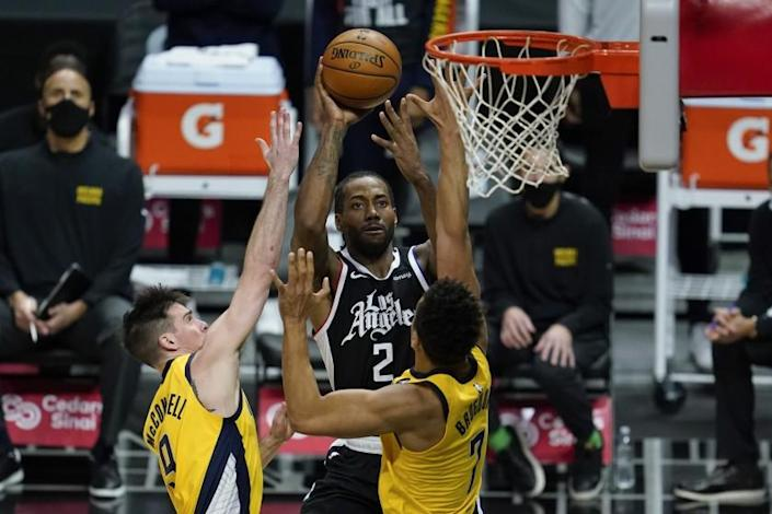 Los Angeles Clippers forward Kawhi Leonard (2) shoots against Indiana Pacers guard T.J. McConnell.