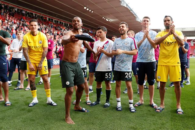 "Soccer Football - Premier League - Southampton vs Manchester City - St Mary's Stadium, Southampton, Britain - May 13, 2018 Manchester City's Fernandinho and teammates celebrate after the match Action Images via Reuters/John Sibley EDITORIAL USE ONLY. No use with unauthorized audio, video, data, fixture lists, club/league logos or ""live"" services. Online in-match use limited to 75 images, no video emulation. No use in betting, games or single club/league/player publications. Please contact your account representative for further details."