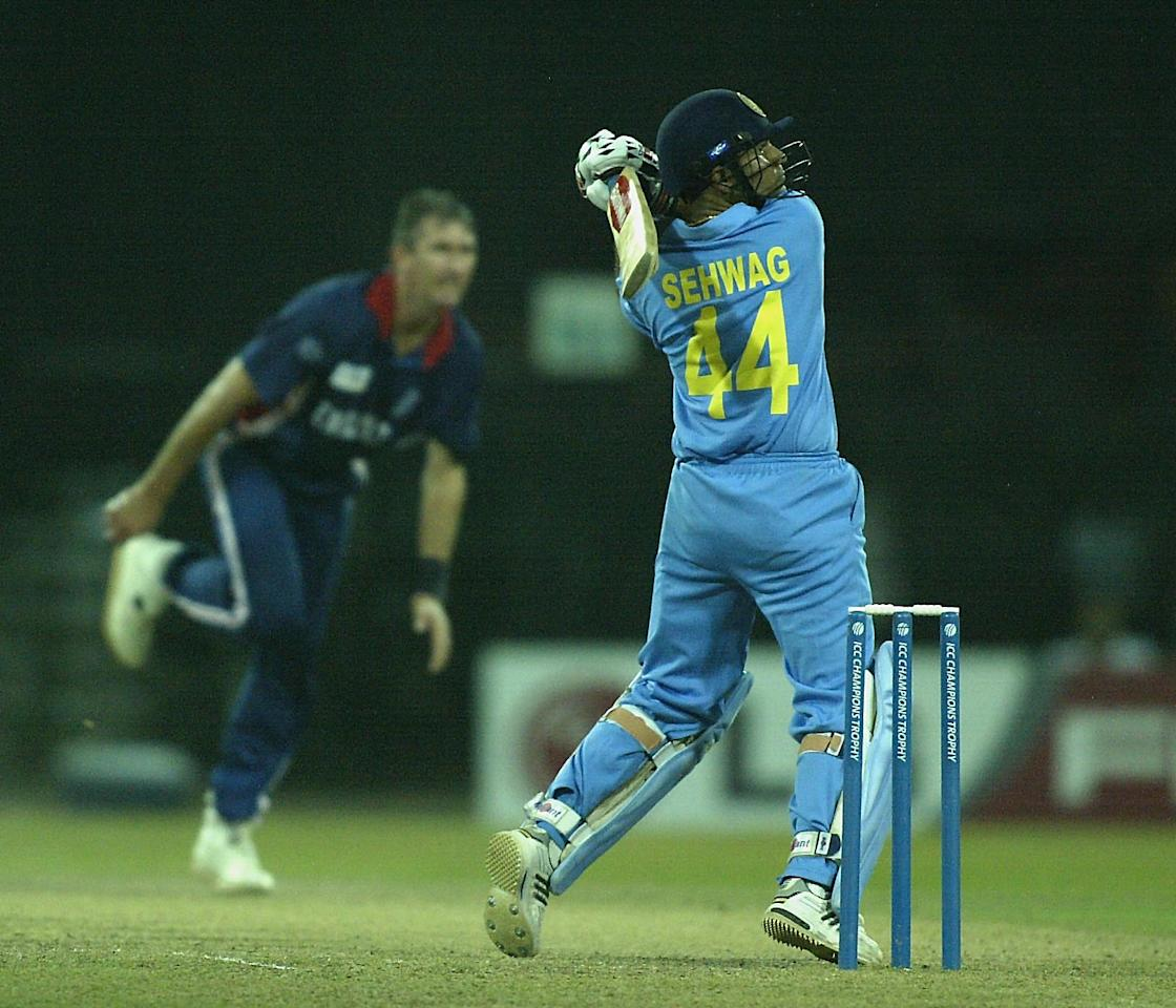 COLOMBO - SEPTEMBER 22:  Virendra Sehwag of India scores off the bowling of Andy Caddick of England during the ICC Champions Trophy match between England and India at the Premadasa Stadium in Colombo, Sri Lanka  on September 22, 2002. (Photo by Clive Mason/Getty Images.)