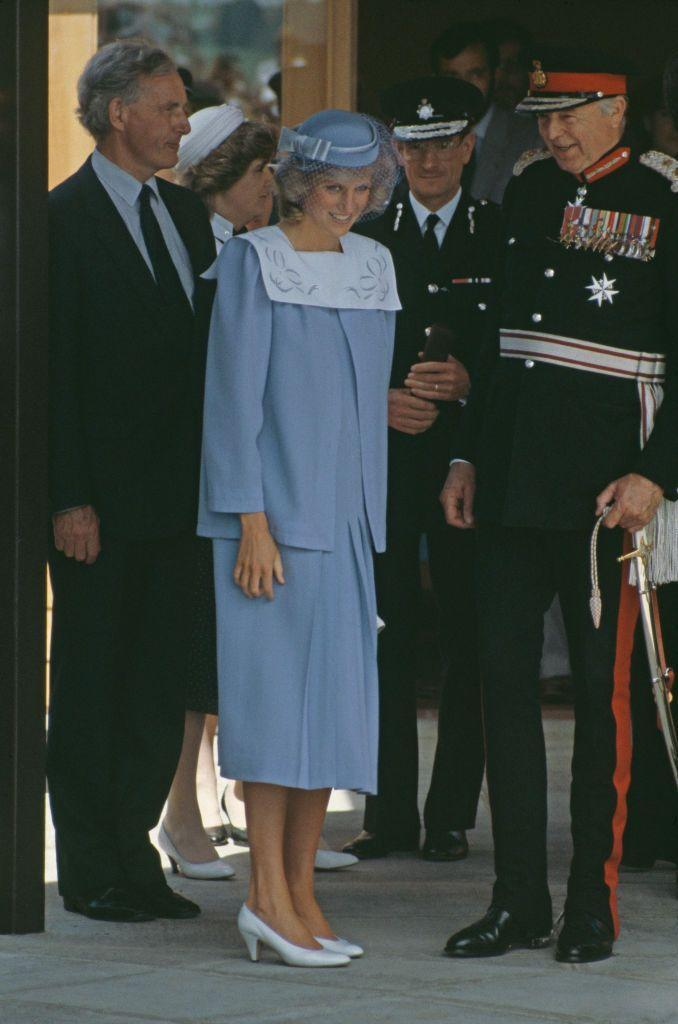 <p>For a visit to a hospital in Salisbury in June 1984, the Princess of Wales once again opted for a Jan Van Velden maternity suit, this time finishing off the look with a John Boyd hat.<br></p>