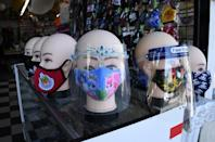 Masks and face shields are seen for sale at a flower shop in Los Angeles in August 2020
