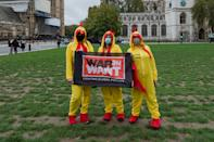 Demonstrators dressed as chlorinated chickens gather in Parliament Square to protest against a post-Brexit trade deal between the UK and the USA on 24 October, 2020 in London, England. Protesters demonstrate against the possibility of opening the NHS to American healthcare companies, lowering food standards, deregulation of environmental and data privacy laws as part of the UK - US trade deal. (Photo by WIktor Szymanowicz/NurPhoto via Getty Images)