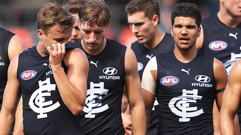 Carlton players, pictured here walking off the field at half-time.