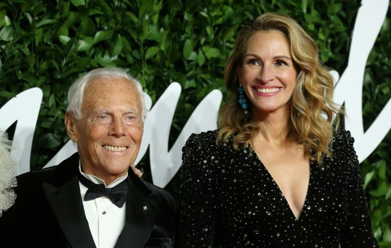 Fashion legend Giorgio Armani received the 'outstanding achievement' award from Hollywood star Julia Roberts (AFP Photo/Isabel Infantes)