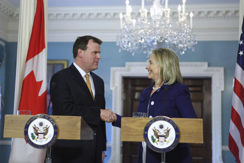 Secretary of State Hillary Rodham Clinton shakes hands with Canadian Foreign Minister John Baird at the State Department in Washington,  Thursday, Aug. 4, 2011. (AP Photo/Jacquelyn Martin)
