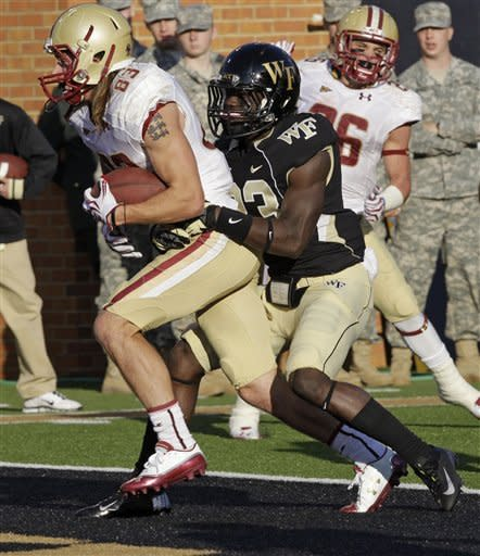 Boston College's Alex Amidon, left, runs into the end zone for a touchdown as Wake Forest's James Ward, right, defends during the first half of an NCAA college football game in Winston-Salem, N.C., Saturday, Nov. 3, 2012. (AP Photo/Chuck Burton)