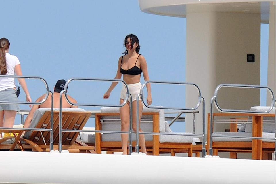 <p>Gomez and friend Cara Delevigne took a yacht vacation together, during which both of them managed to look like this was just a normal Tuesday or something.</p>