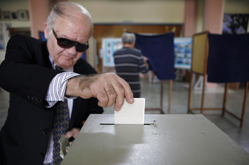 A man votes in the presidential election in southern port city of Limassol, Cyprus, Sunday, Feb. 24, 2013. Opposition party leader Nicos Anastasiades garnered 45.46 per cent of the vote in the first round of voting, some 18 points over communist-backed Stavros Malas. (AP Photo/Petros Karadjias)