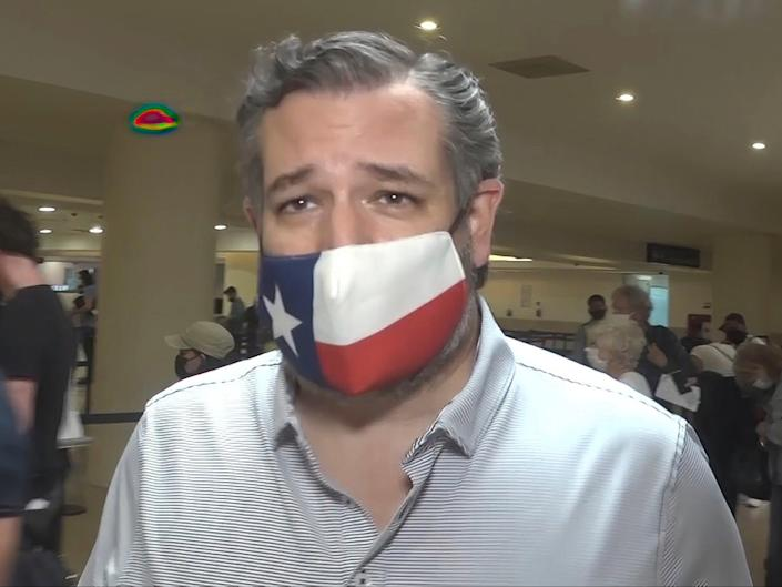 Senator Ted Cruz walks to check in for his flight back to the US at Cancun International Airport in Cancun, Mexico on 18 February 2021 (AP Photo/Dan Christian Rojas)
