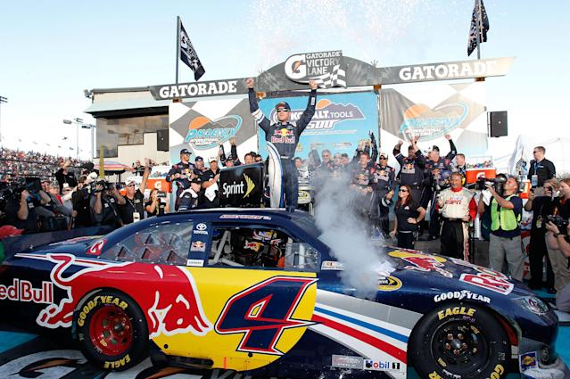 AVONDALE, AZ - NOVEMBER 13: Kasey Kahne, driver of the #4 Red Bull Toyota, celebrates in victory lane after winning the NASCAR Sprint Cup Series Kobalt Tools 500 at Phoenix International Raceway on November 13, 2011 in Avondale, Arizona. (Photo by Geoff Burke/Getty Images for NASCAR)