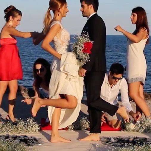 Footage of the ceremony shows a couple being supported - and having the feet brushed off - during the walk. Photo: Caters