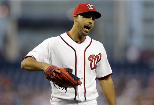 Washington Nationals starting pitcher Gio Gonzalez (47) reacts as he comes off the field during the first inning of an interleague baseball game against the Chicago White Sox at Nationals Park Tuesday, April 9, 2013, in Washington. Gonzalez was called for balk that resulted in a run for the Chicago White Sox. (AP Photo/Alex Brandon)