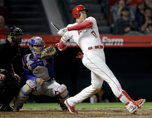 Los Angeles Angels' Shohei Ohtani, of Japan, breaks his bat as he grounds out during the eighth inning of a baseball game against the Texas Rangers in Anaheim, Calif., Tuesday, Sept. 25, 2018. (AP Photo/Chris Carlson)