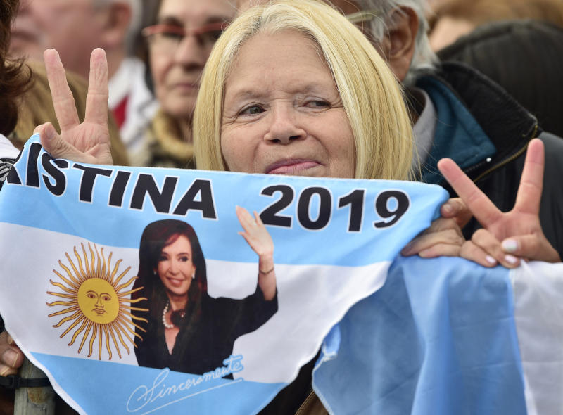 A supporters of presidential candidate Alberto Fernandez and his running-mate, former President Cristina Fernandez, no relation, holds a banner that show an image of the former leader, during the kick-off political campaign rally,at the Nestor Kirchner Park, in Buenos Aires, Argentina, Saturday, May 25, 2019. Argentina will hold general presidential elections on Oct 27.(AP Photo/Gustavo Garello)