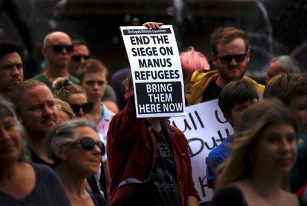 Refugee advocates hold placards as they participate in a protest in Sydney, Australia, against the treatment of asylum-seekers at Australia-run detention centres located at Nauru and Manus Island, November 18, 2017. REUTERS/David Gray