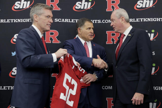 New Rutgers NCAA college football coach Greg Schiano, center, talks with New Jersey Gov. Phil Murphy, right, and Rutgers athletic director Pat Hobbs after an introductory news conference in Piscataway, N.J., Wednesday, Dec. 4, 2019. After an on-again, off-again courtship, Schiano is back as Rutgers football coach. (AP Photo/Seth Wenig)