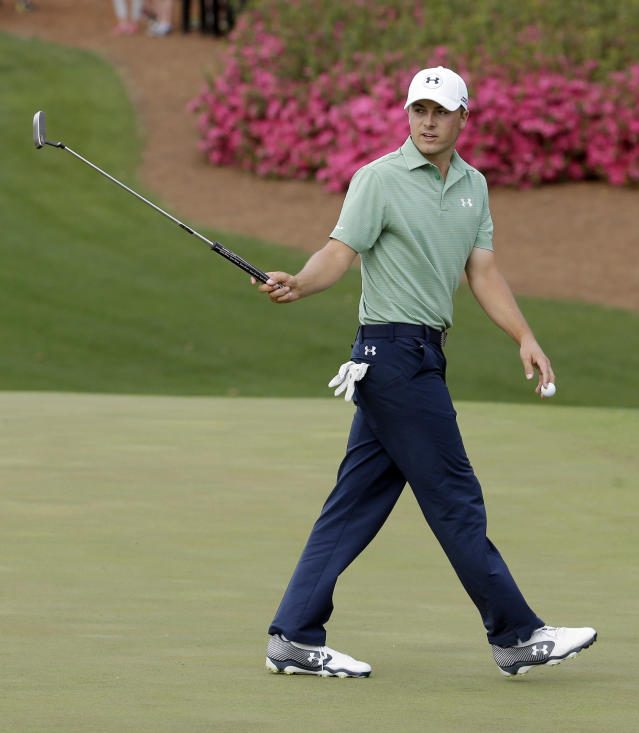 Jordan Spieth waves his putter after a par putt on the 10th hole during the fourth round of the Masters golf tournament Sunday, April 13, 2014, in Augusta, Ga. (AP Photo/Charlie Riedel)