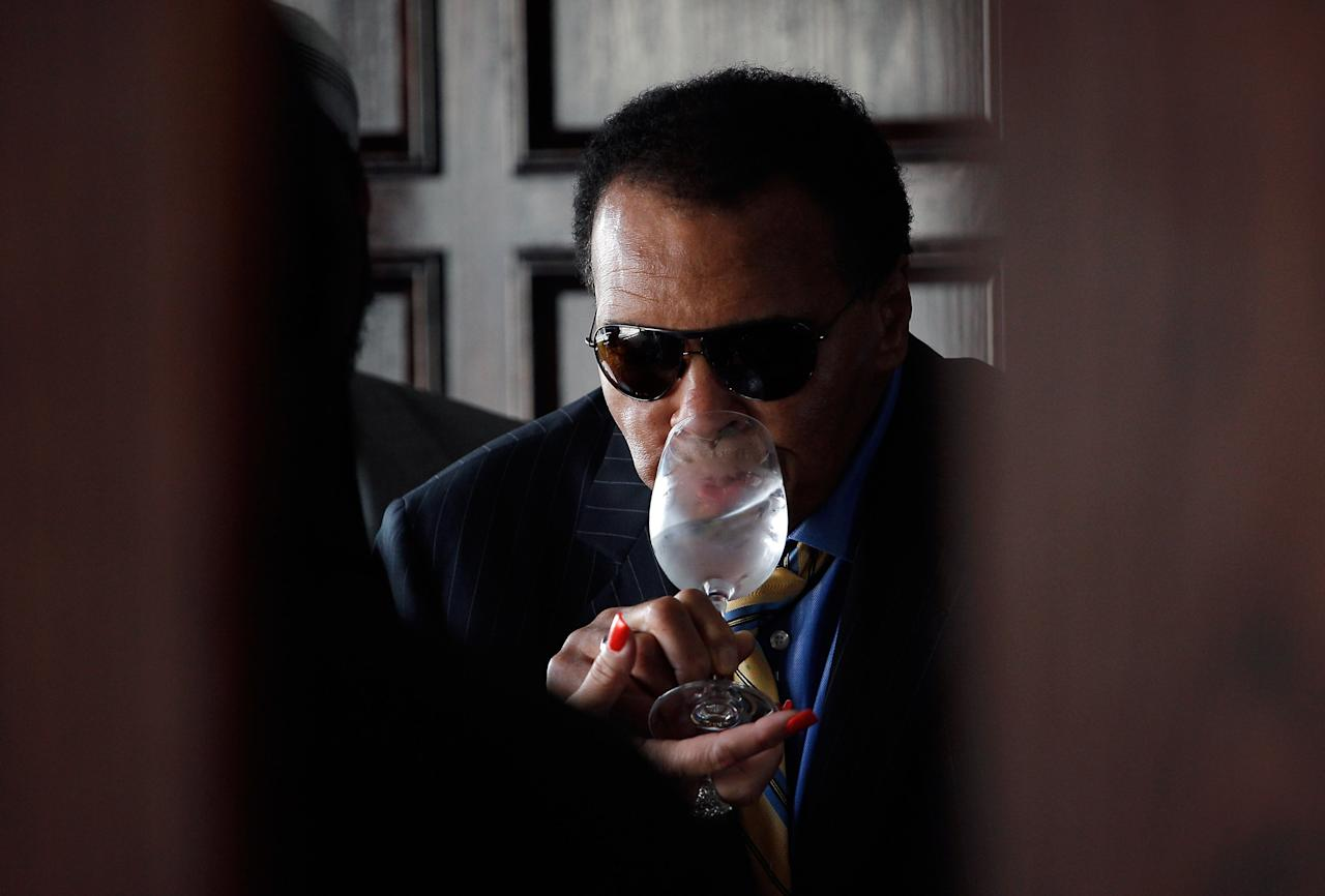 WASHINGTON, DC - MAY 24:  Former World Heavyweight Boxing Champion Muhammad Ali is assisted with drinking a glass of water after joining other prominent American Muslims and clergy attending a news conference at the National Press Club on May 24, 2011 in Washington, DC. Ali and other prominent American Muslims and clergy appealed to Iran's Supreme Leader for the release Shane Bauer and Josh Fattal, the two U.S. hikers detained in Iran since July 31, 2009.  (Photo by Win McNamee/Getty Images)