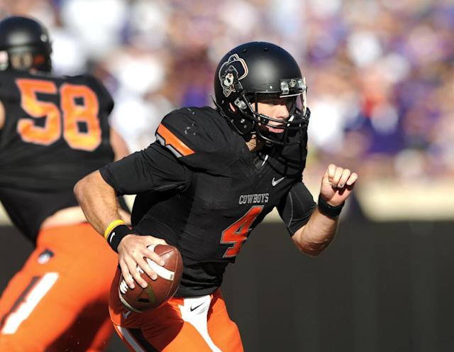 Oklahoma State quarterback J.W. Walsh runs during the second half of an NCAA football game against Kansas State in Stillwater, Okla., Saturday, Oct. 5, 2013. Oklahoma State won 33-29. (AP Photo/Brody Schmidt)
