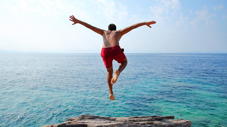 Young man diving.