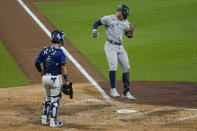 New York Yankees designated hitter Giancarlo Stanton jumps on home plate after hitting a grand slam home run against the Tampa Bay Rays during the ninth inning in Game one of a baseball American League Division Series Monday, Oct. 5, 2020, in San Diego. (AP Photo/Gregory Bull)