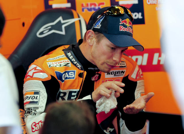 Repsol Honda Team's Australian Casey Stoner speaks with his engineers in his pits at the Catalunya racetrack in Montmelo, near Barcelona, on June 2, 2012, during the MotoGP third training session of the Catalunya Moto GP Grand Prix. AFP PHOTO / JOSEP LAGOJOSEP LAGO/AFP/GettyImages