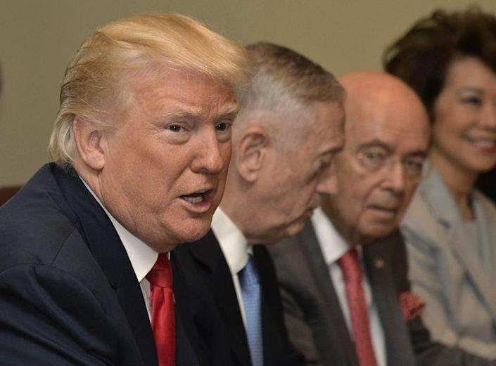 President Trump at a Cabinet meeting July 31, with, from left, Defense Secretary James Mattis, Commerce Secretary Wilbur Ross and Transportation Secretary Elaine Chao. (Photo: Mike Theiler/Pool, Getty Images)