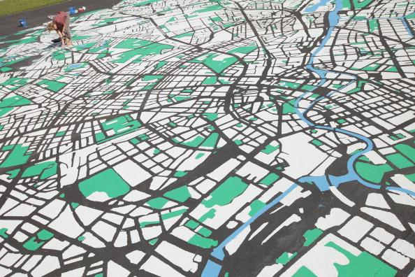 Landscape architect Lisa Hankow paints a giant map of Berlin in the city center on August 6, 2012 in Berlin, Germany. The map, which will measure 50 meters X 50 meters when finished, is in the scale of 1:775 and is an art installation meant to coincide with 775th anniversary of Berlin, which the city will celebrate in October. (Photo by Sean Gallup/Getty Images)