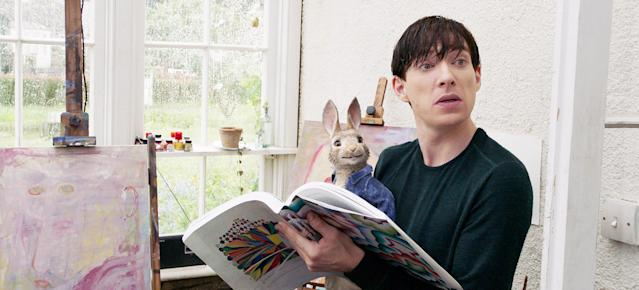 Domhnall Gleeson cuddles up with the titular bunny in <em>Peter Rabbit.</em> (Photo: Columbia Pictures/Courtesy Everett Collection)