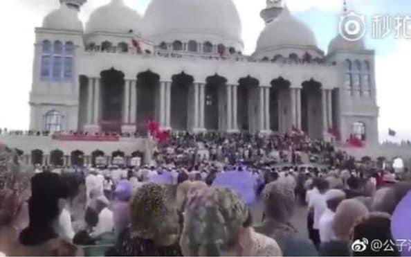 A large crowd of Hui people, a Muslim ethnic minority, began congregating at the towering Grand Mosque in the town of Weizhou on Thursday