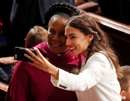 FILE PHOTO: Representative-elect Alexandria Ocasio-Cortez (D-NY) takes selfie with Jackson Lee  as the U.S. House of Representatives meets for the start of the 116th Congressin Washington