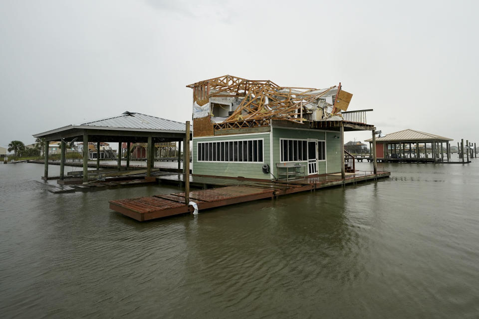 A damaged home is shown Friday, Aug. 28, 2020, in Hackberry, La., after Hurricane Laura move through the area Thursday. (AP Photo/David J. Phillip)
