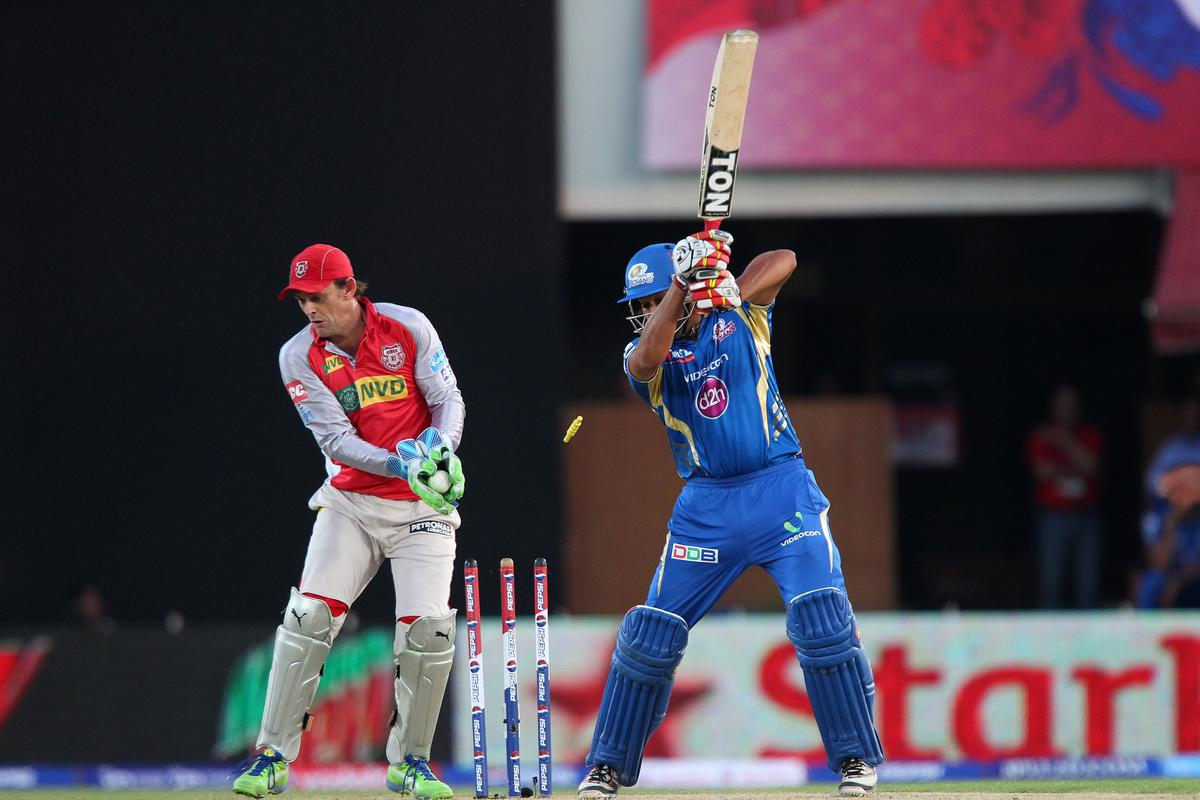 Rohit Sharma is clean bowled by Piyush Chawla during match 69 of the Pepsi Indian Premier League between The Kings XI Punjab and the Mumbai Indians held at the HPCA Stadium in Dharamsala, Himachal Pradesh, India on the on the 18th May 2013. (BCCI)