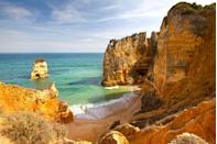 <p>Surrounded by cliffs, this small beach outside of Lagos is one of the most beautiful in Portugal's Algarve region.</p>