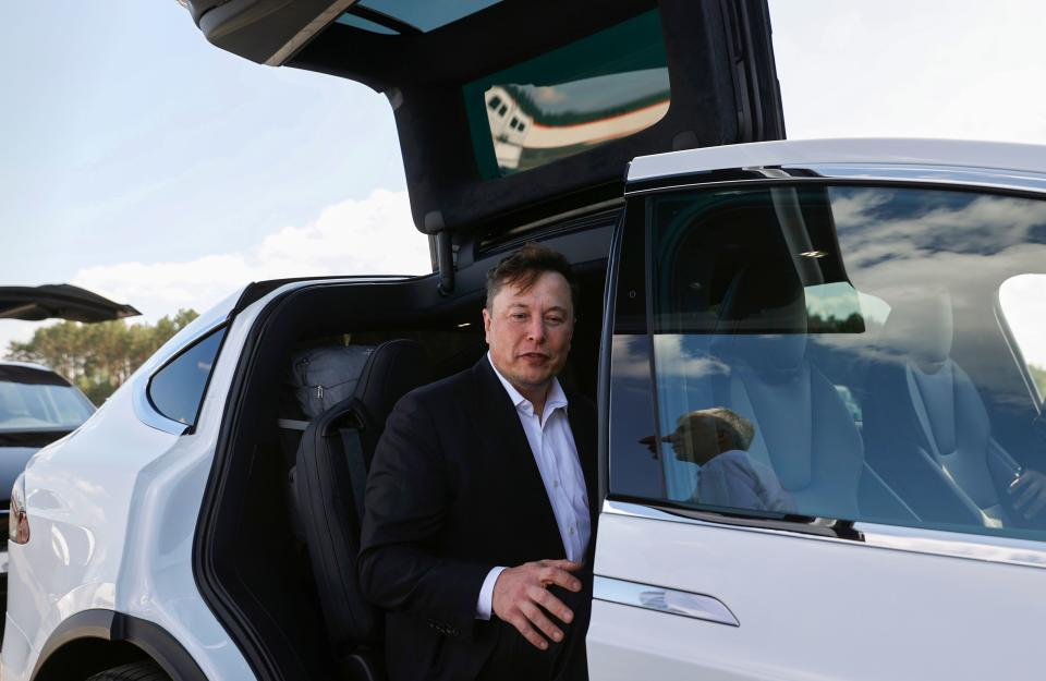 """Tesla CEO Elon Musk gets back into his Tesla after talking to media before visiting the construction site of the future US electric car giant Tesla, on September 03, 2020 in Gruenheide near Berlin. - Tesla builds a compound at the site in Gruenheide in Brandenburg for its first European """"Gigafactory"""" near Berlin. (Photo by Odd ANDERSEN / AFP) (Photo by ODD ANDERSEN/AFP via Getty Images)"""