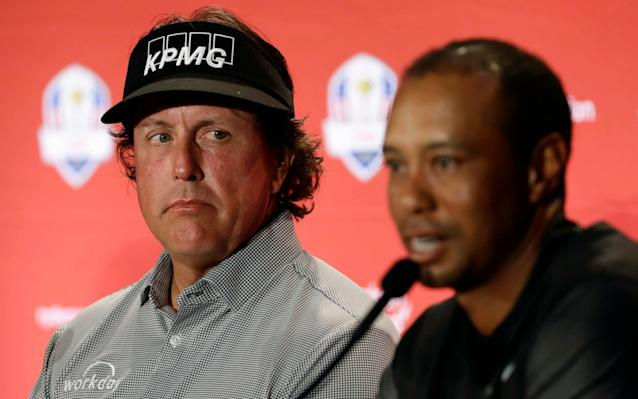 Tiger Woods (right) and Phil Mickelson (left) spur each other on - AP