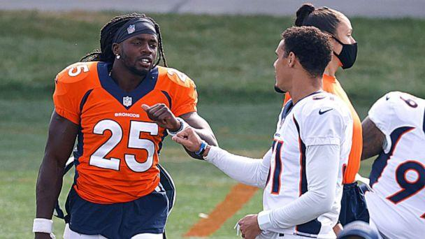 PHOTO: Denver Broncos running back Melvin Gordon, left, greets safety Justin Simmons as they take part in drills during an NFL football practice, Aug. 28, 2020, in Englewood, Colo. (David Zalubowski/AP)